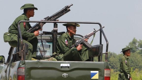 Heavily armed Myanmar army troops patrol Kyinkanpyin area in Maungdaw town, Rakhine State October 16, 2016.