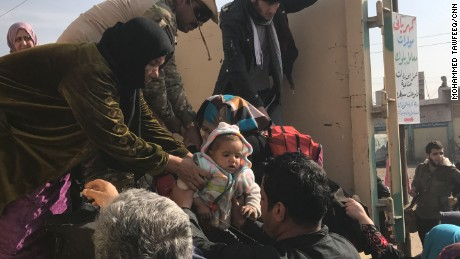 Women and children scramble to flee the fighting as Iraqi forces seek to retake Mosul from ISIS.