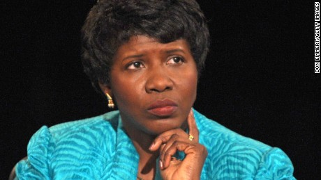 PBS journalist and debate moderator Gwen Ifill looks at Democratic vice presidential candidate U.S. Senator Joe Biden during the vice presidential debate at the Field House of Washington University's Athletic Complex in October 2008 in St. Louis, Missouri.