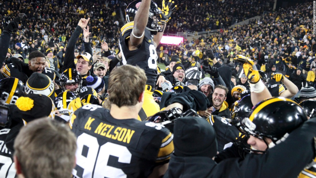 The Iowa Hawkeyes celebrate after their 14-13 win over No. 3 Michigan on Saturday, November 12. Keith Duncan kicked a 33-yard field goal as time expired to hand Michigan its first loss of the season. No. 2 Clemson and No. 4 Washington also lost, leaving Alabama and Western Michigan as the only undefeated teams in the top tier of college football.