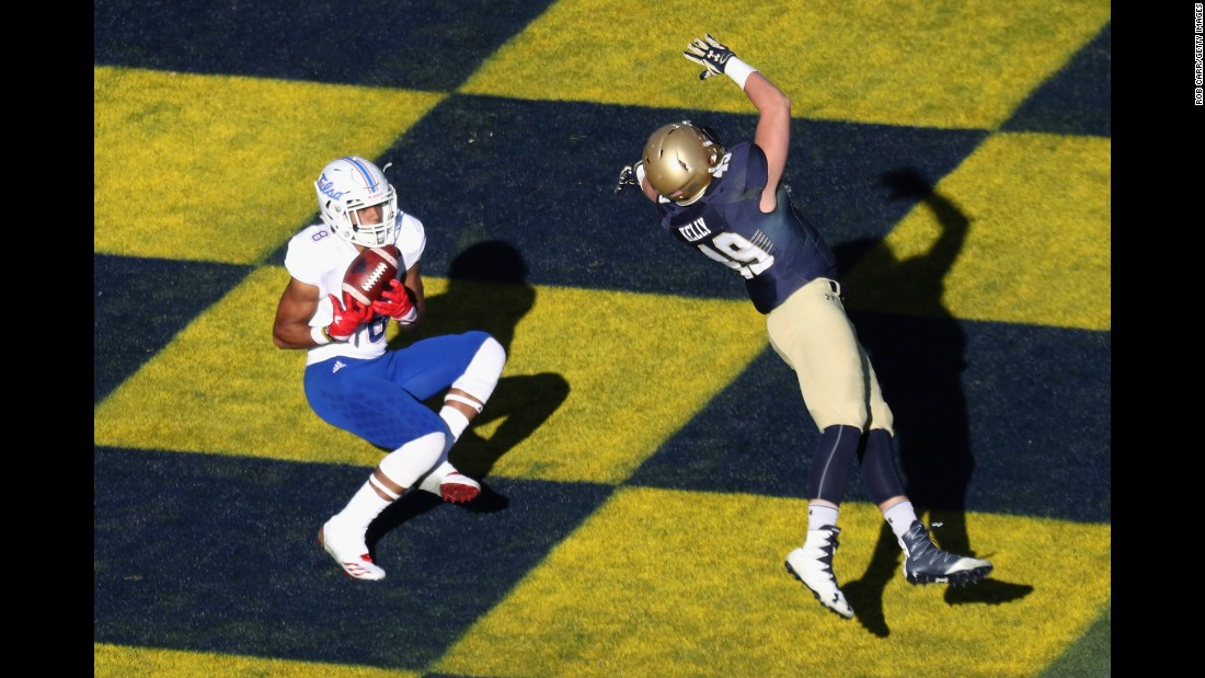 Tulsa's Keenen Johnson catches a second-half touchdown pass at Navy on Saturday, November 12. Navy won a 42-40 shootout.