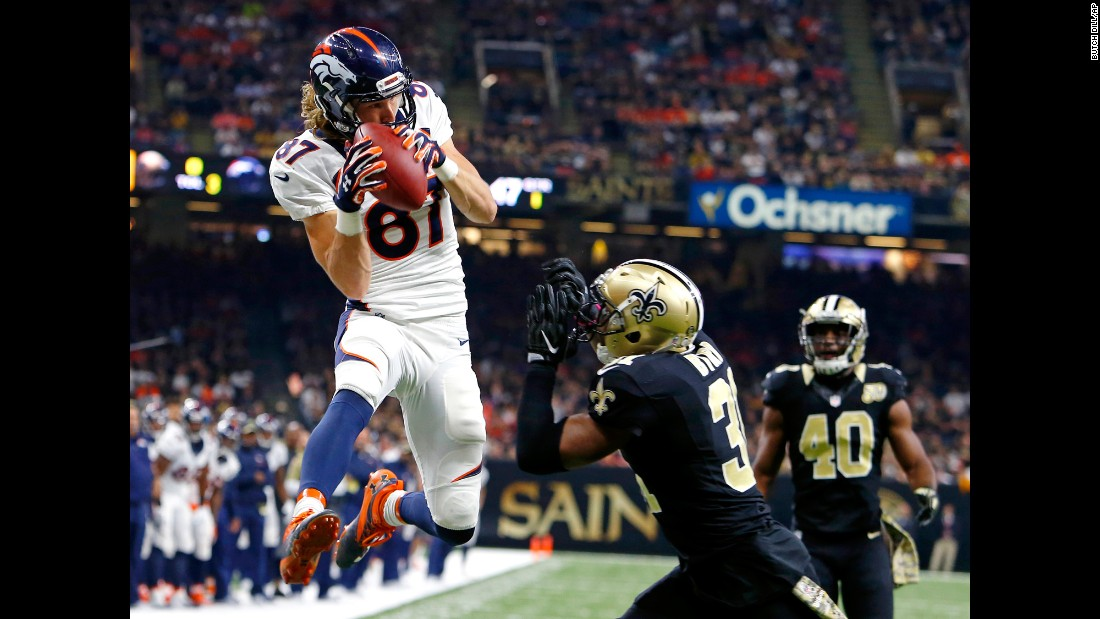 Denver wide receiver Jordan Taylor pulls in a touchdown pass in front of New Orleans safety Jairus Byrd during an NFL game on Sunday, November 13. Denver won 25-23 after returning a blocked extra point.