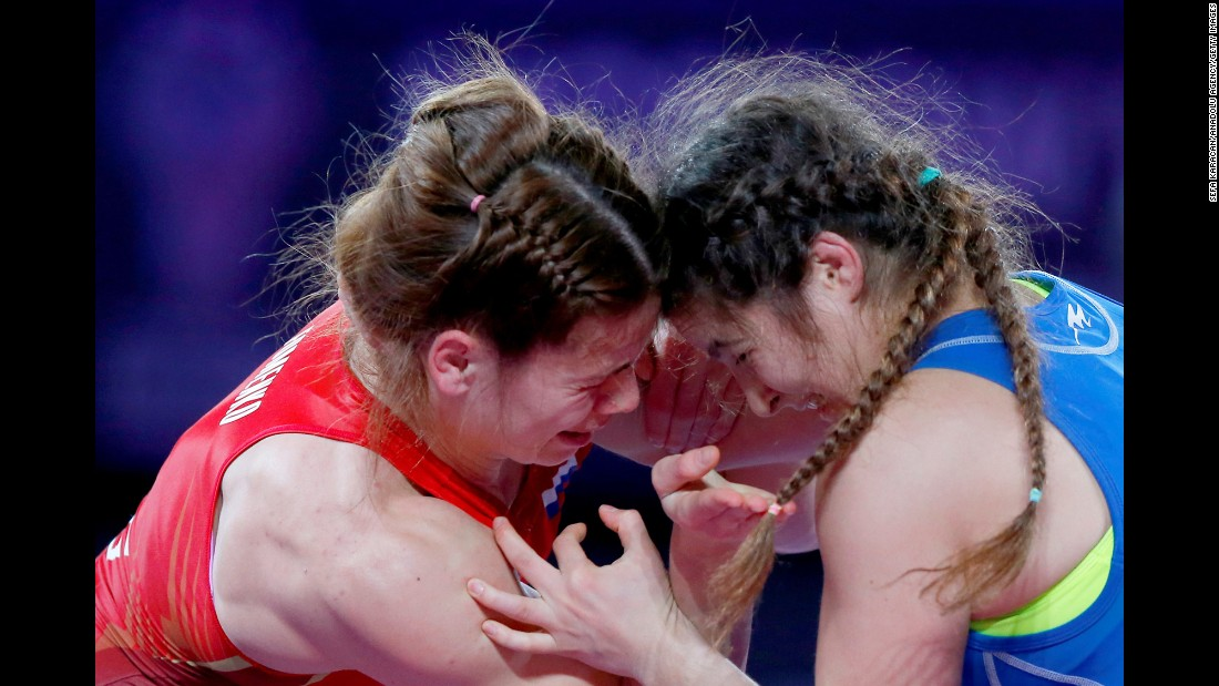 Russia's Anzhela Fomenko, left, wrestles Azerbaijan's Elmira Gambarova during the Alrosa Cup in Moscow on Sunday, November 13.
