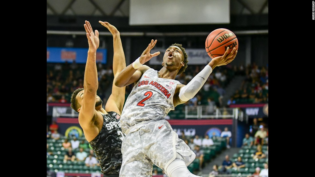 Arizona guard Kobi Simmons is defended by Michigan State's Kenny Goins during the Armed Forces Classic, the two teams' season opener on Friday, November 11. Arizona won 65-63 with a late basket by Kadeem Allen.