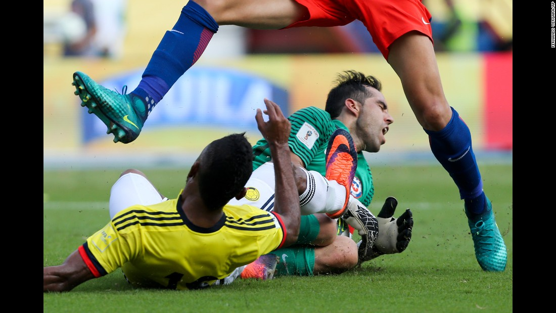 Colombia's Miguel Borja, left, collides with Chile goalkeeper Claudio Bravo during a World Cup qualifier in Barranquilla, Colombia, on Thursday, November 10. The match ended scoreless.