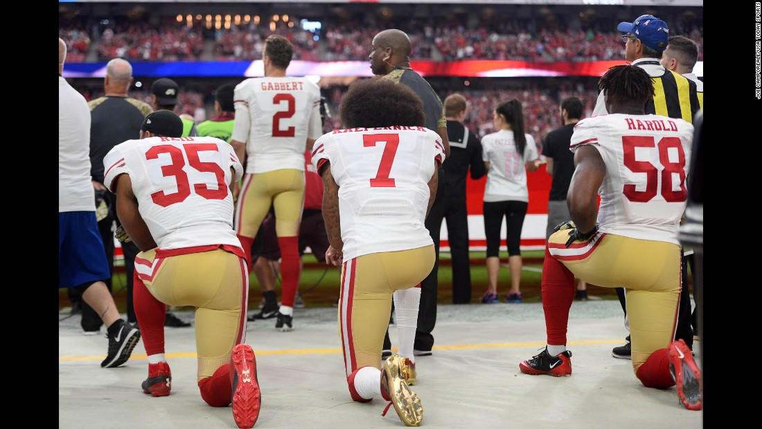 "From left, San Francisco 49ers Eric Reid, Colin Kaepernick and Eli Harold kneel during the national anthem on Sunday, November 13. After the game in Arizona, Kaepernick explained to the media <a href=""http://www.cnn.com/2016/11/14/sport/49ers-qb-colin-kaepernick-explains-why-he-didnt-vote/index.html"" target=""_blank"">why he didn't vote</a> in the presidential election. ""You know, I think it would be hypocritical of me to vote,"" said Kaepernick, who began protesting the anthem in August. ""I said from the beginning I was against oppression, I was against the system of oppression. I'm not going to show support for that system. And to me, the oppressor isn't going to allow you to vote your way out of your oppression."" <a href=""http://www.cnn.com/2016/11/07/sport/gallery/what-a-shot-sports-1108/index.html"" target=""_blank"">See 25 amazing sports photos from last week</a>"