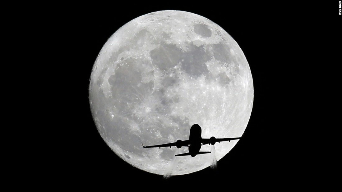 A passenger plane passes in front of the moon, as seen from Whittier, California, on November 13.