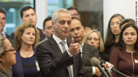 Chicago Mayor Rahm Emanuel, center, says the outcome of the  presidential election will not affect Chicago's commitment as a sanctuary city.