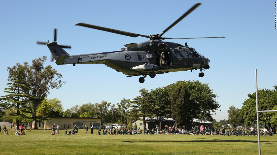 Tourists evacuated from Kaikoura arrive by helicopter at Woodend School grounds in Christchurch on November 15. People were evacuated from Kaikoura by air, after landslides triggered by the earthquake cut off road access to the popular tourist destination.