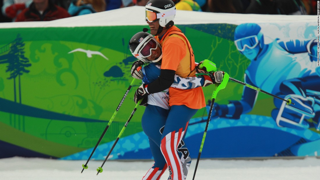 """I didn't start living my life until I started sport. And sport has given me the life that I love and enjoy,"" Danelle says. Pictured, Danelle and Rob celebrate at the 2010 Vancouver Winter Paralympics."