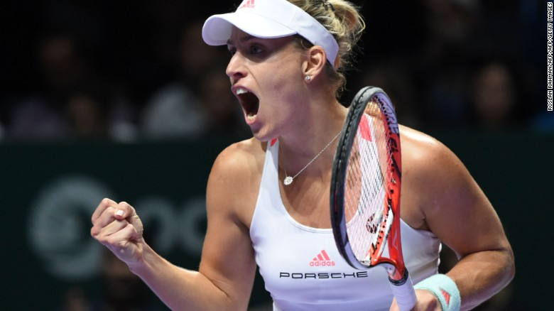 Angelique Kerber of Germany celebrates a point against Dominika Cibulkova of Slovakia during their women's singles final match at the WTA Finals tennis tournament in Singapore on October 30, 2016. / AFP / ROSLAN RAHMAN        (Photo credit should read ROSLAN RAHMAN/AFP/Getty Images)