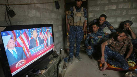 Members of the Iraqi forces watch Donald Trump giving a speech after he won the US president elections in the village of Arbid on the southern outskirts of Mosul on November 9, 2016, as they rest in a house during the ongoing military operation to retake Mosul from the Islamic State (IS) group.