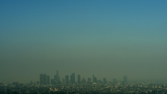 A view of the Los Angeles city skyline as heavy smog shrouds the city in California on May 31, 2015.           AFP PHOTO/ MARK RALSTON