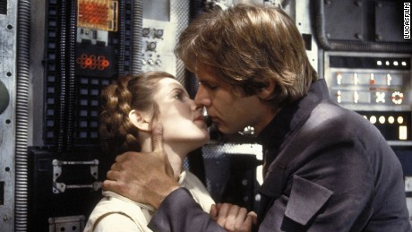"Carrie Fisher and Harrison Ford kiss in a scene from ""The Empire Strikes Back."""