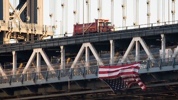 Anti-Trump protesters in New York hung an upside-down American flag from the side of the Manhattan Bridge on November 14.