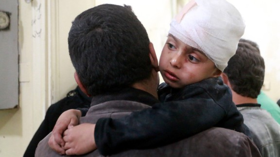 A boy receives medical treatment after being injured in an airstrike Tuesday.