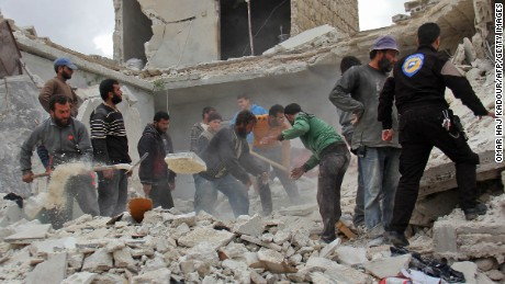 Rescuers and civilians inspect a destroyed building in the Syrian village of Kfar Jales, on the outskirts of Idlib, following air strikes by Syrian and Russian warplanes on November 16, 2016.   Syrian and Russian warplanes bombed rebel-held areas in Aleppo and Idlib province overnight, a monitor said, a day after Moscow announced a fresh offensive against opponents of its Damascus ally.   / AFP / Omar haj kadour        (Photo credit should read OMAR HAJ KADOUR/AFP/Getty Images)