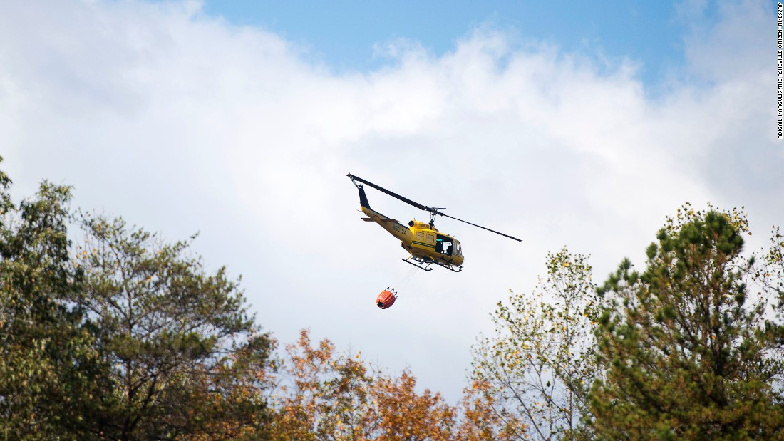 A helicopter carrying 240 gallons of water takes off in Lake Lure, North Carolina, on November 10.