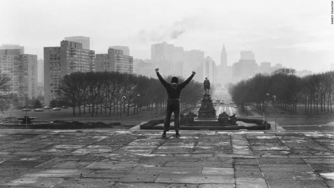 "In this iconic scene from the 1976 film ""Rocky,"" the title character triumphantly raises his arms after climbing the steps of the Philadelphia Museum of Art. The small-budget film, made for just a little more than $1 million, premiered on November 21, 1976, and went on to become the year's biggest box-office hit. It won three Academy Awards, including Best Picture, and it made lead actor Sylvester Stallone an overnight star. Forty years later it remains one of the greatest sports movies of all time, spawning six sequels -- the most recent being ""Creed"" in 2015."
