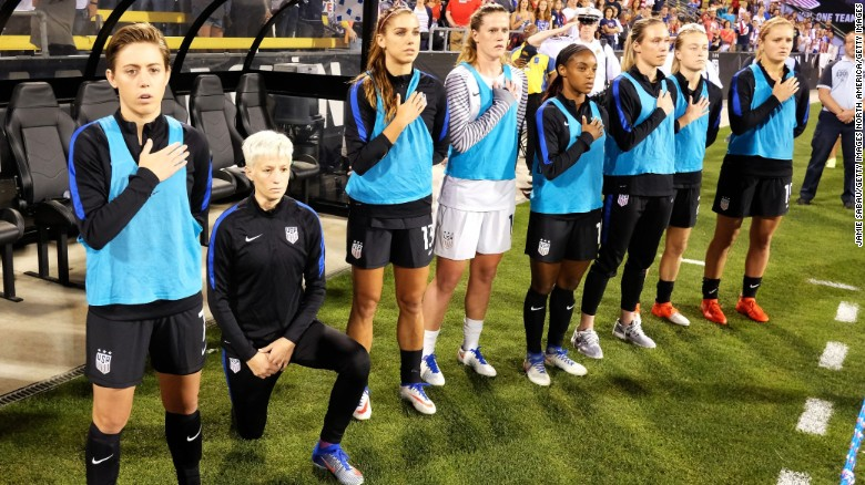 Megan Rapinoe of the US Women's team kneels during the playing of the national anthem.