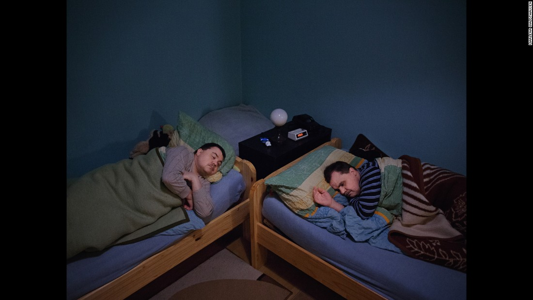 Twin brothers Jörg and Rolf Fischer sleep together at Rolf's dormitory in Germany. Both were born deaf, and they have lost their eyesight because of diabetes -- although Rolf can still see a little bit out of one eye. Photographer Marlena Waldthausen spent a few months with the twins and learned how they navigate the world together.