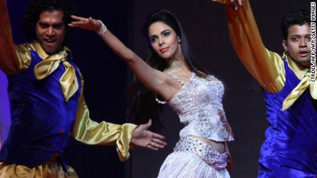 Indian Bollywood actress Mallika Sherawat (C) performs with dancers during New Year eve celebrations in Mumbai on December 30, 2011. AFP PHOTO/STR (Photo credit should read STRDEL/AFP/Getty Images)
