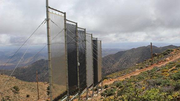 In a mountainous area on the edge of the Sahara in Southwest Morocco, large mesh nets capture clouds of fog and condense it into clean drinking water.