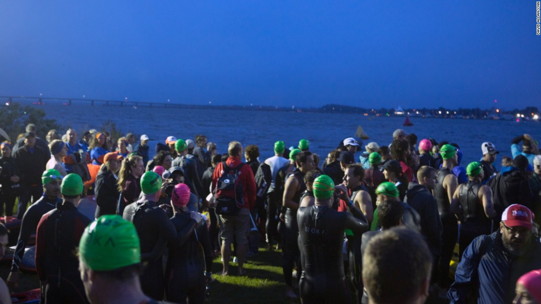 One of the many Ironman triathlons held around the world every year is in the small town of Cambridge, Maryland, along the eastern coast of the Chesapeake Bay. Swimmers gather before dawn for the start.