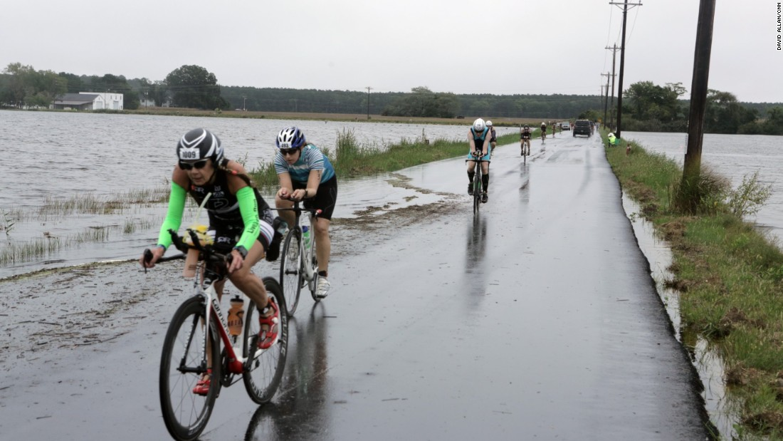 When rain and high tides caused flooding on local roads, the bike course needed to be rerouted this year.