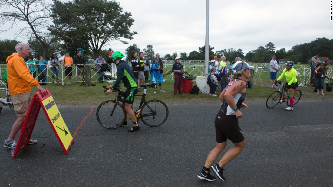"Back at the base, triathletes ""transition"" from cycling to the run portion of the race."