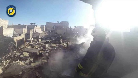 Many in Aleppo are trapped under the rubble of Thursday's strikes, a volunteer civil defense group says.