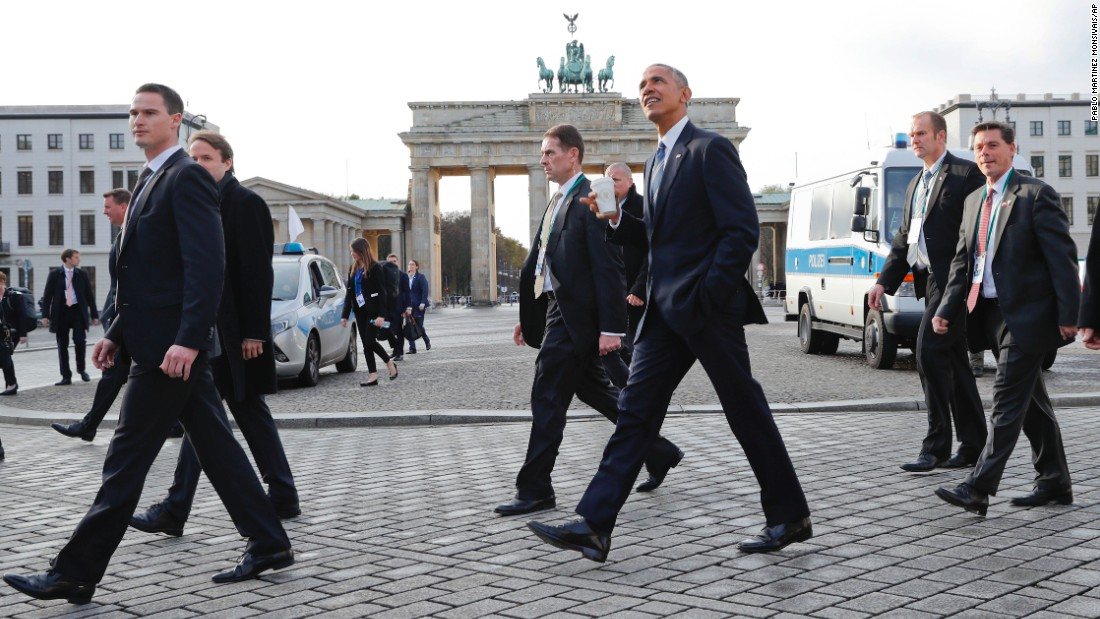 Obama walks past the Brandenburg Gate after visiting the US Embassy in Berlin on November 17.