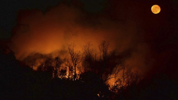 A wildfire burns as it approaches Bat Cave, North Carolina, on November 15.