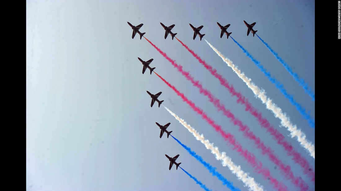 The Red Arrows, the aerobatic team of the British Royal Air Force, perform on the outskirts of Hyderabad, India, on Thursday, November 17.