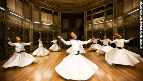 Whirling dervishes perform at the Galata Mevlevihane (The Lodge of the Dervishes) in Istanbul on December 18, 2013. The dervishes are adepts of Sufism, a mystical form of Islam that preaches tolerance and a search for understanding. Those who whirl, like planets around the sun, turn dance into a form of prayer.   AFP PHOTO/GURCAN OZTURK        (Photo credit should read GURCAN OZTURK/AFP/Getty Images)