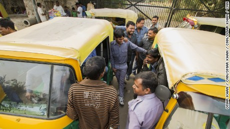 Sarvesh and the other drivers chat and laugh, despite the tough circumstances.