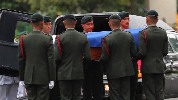 An image taken from a video posted by Imee Marcos shows Marcos' casket being carried to its resting place.