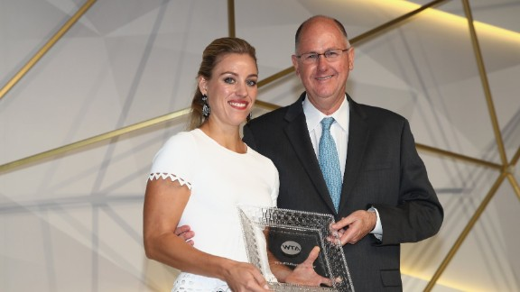 SINGAPORE - OCTOBER 21:  Angelique Kerber of Germany receives the 2016 Player of the Year Award from Steve Simon, WTA CEO during the Gala Dinner prior to the BNP Paribas WTA Finals Singapore at Marina Bay Sands on October 21, 2016 in Singapore.  (Photo by Julian Finney/Getty Images)