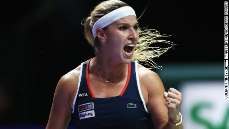 SINGAPORE - OCTOBER 23:  Dominika Cibulkova of Slovakia celebrates a point in her singles match against Angelique Kerber of Germany during day 1 of the BNP Paribas WTA Finals Singapore at Singapore Sports Hub on October 23, 2016 in Singapore.  (Photo by Julian Finney/Getty Images)