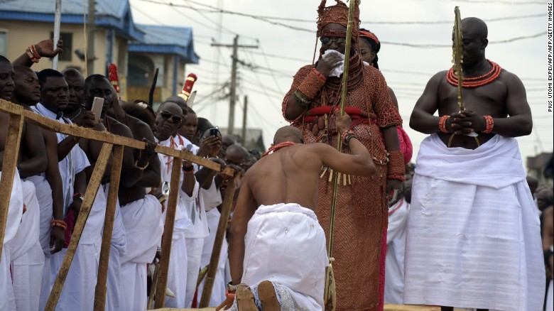 A palace aide kneels down before newly crowned Monarch. Kingship as an institution is much more than a ceremony hence the kingdom's strict and largely uncompromising adherence to ancient customs and traditions.