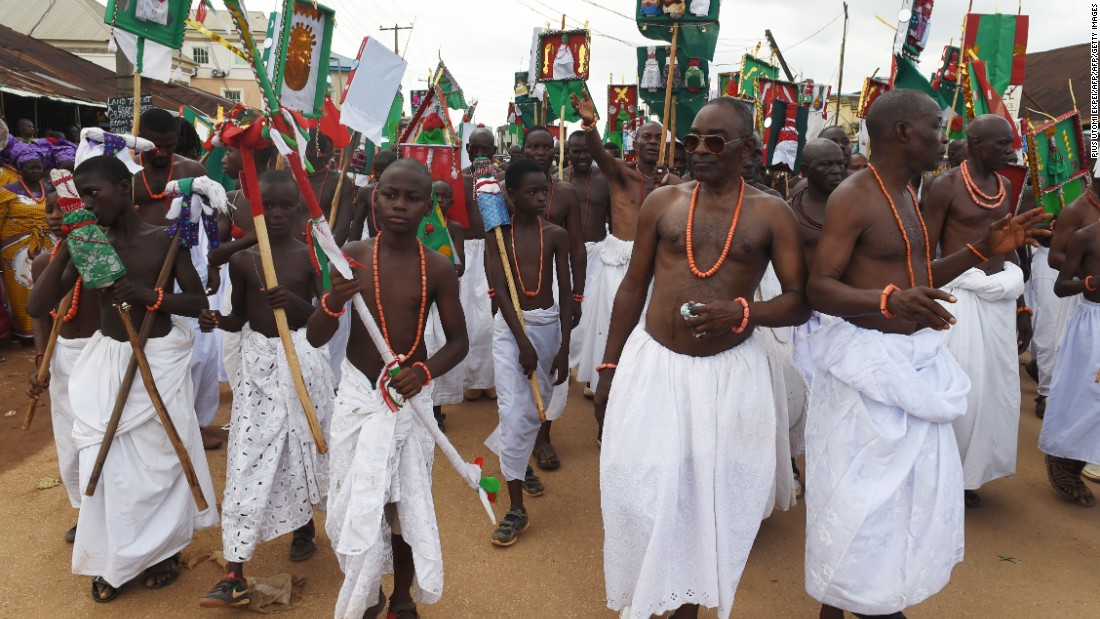 Royalist supporters dance and parade during the coronation ceremony of the new Oba.