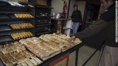 "A man buys bread at a bakery in Buenos Aires, on May 17, 2016. Employment and inflation are the Argentinians' main concern almost six months after the instalation of President Mauricio Macri, though the majority thinks he ""needs time"", a poll revealed Tuesday. / AFP / EITAN ABRAMOVICH        (Photo credit should read EITAN ABRAMOVICH/AFP/Getty Images)"
