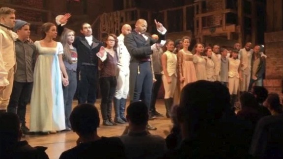 """In this image made from a video provided by Hamilton LLC, actor Brandon Victor Dixon who plays Aaron Burr, the nation's third vice president, in """"Hamilton"""" speaks from the stage after the curtain call in New York, November 18. Vice President-elect Mike Pence is the latest celebrity to attend the Broadway hit """"Hamilton,"""" but the first to get a sharp message from a cast member from the stage."""