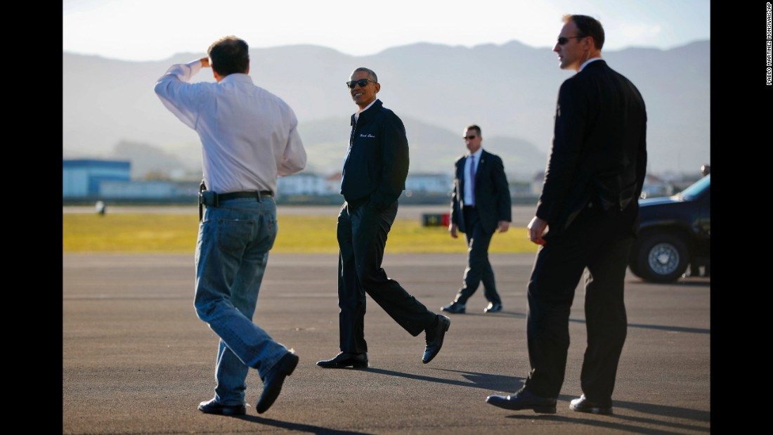 Obama walks across the tarmac during the refueling stop in the Azores.
