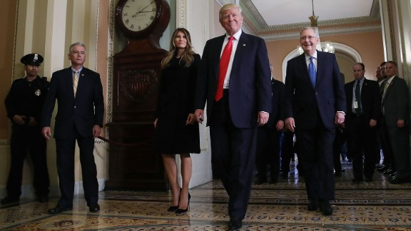 Trump walks with his wife and Senate Majority Leader Mitch McConnell after a meeting at the US Capitol on November 10.