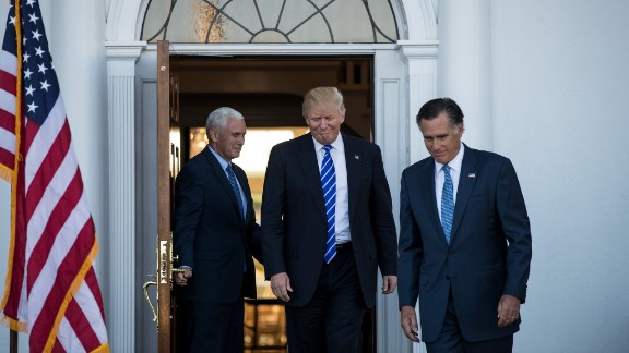 Trump is flanked by Pence and  Romney after a meeting in Bedminster Township, New Jersey, on Saturday, November 19.