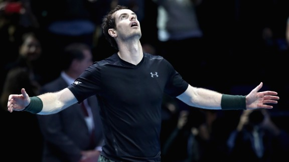 Andy Murray of Great Britain celebrates defeating Milos Raonic of Canada in their men's singles semi final on day seven of the ATP World Tour Finals at O2 Arena on November 19 in London, England.