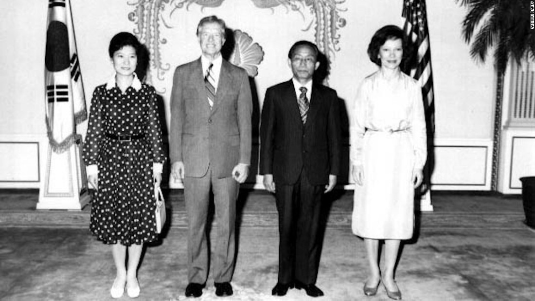 Park Geun-hye, left, stands next to US President Jimmy Carter during Carter's state visit to Seoul in 1979. After Park's mother was killed in a botched assassination attempt on her father in 1974, Park became regarded as South Korea's first lady.