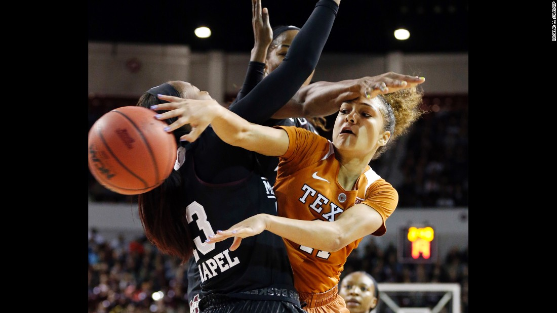 Texas guard Brooke McCarty passes around Mississippi State forward Ketara Chapel during a college basketball game in Starkville, Mississippi, on Sunday, November 20.