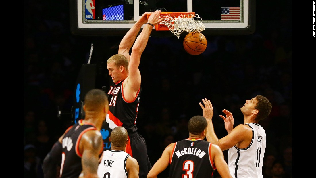 Portland's Mason Plumlee throws down a reverse dunk during an NBA game against Brooklyn on Sunday, November 20.